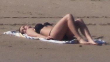 Gabriella Duddy poses on North Bondi to demonstrate how the paparazzi was able to snap the topless photo of Kate Middleton.