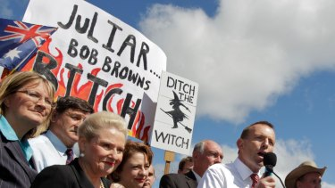 Then opposition leader Tony Abbott speaks flanked by party colleagues including Bronwyn Bishop and Sophie Mirabella at the infamous no carbon tax rally outside Parliament House in Canberra in 2011.