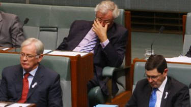 Dissenting backbenchers Wilson Tuckey centre top, failed leadership aspirant Kevin Andrews right and Andrew Robb left, in Parliament.