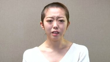 'Medieval' ... Minami Minegishi apologises for breaking band's rules by shaving her head.