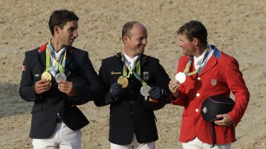Podium trio: Michael Jung of Germany is flanked by silver medalist Astier Nicolas of France (left) and bronze medalist Phillip Dutton, of the United States.