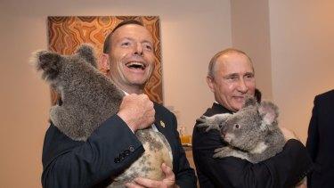 Cuddling koalas, not shirt-fronting ... Australia's Prime Minister Tony Abbott and Russia's President Vladimir Putin cuddle koalas before the start of the first G20 meeting on November 15, 2014 in Brisbane.
