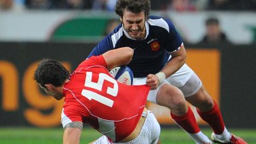 France's fullback Maxime Medard  fights for the ball with Wales full back Lee Byrne.