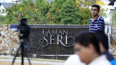 Journalists wait outside the missing Malaysia Airlines pilot Zaharie Ahmad Shah's house near Kuala Lumpur.