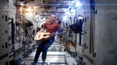 Canadian astronaut Chris Hadfield performs his zero-gravity version of David Bowie's hit, <i>Space Oddity</i>.