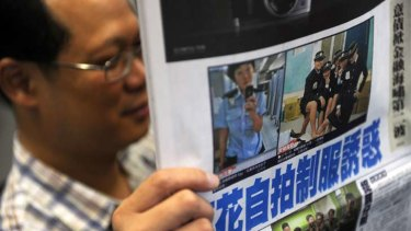 Photos splashed across the newspapers ... Hong Kong police have launched an internal inquiry.