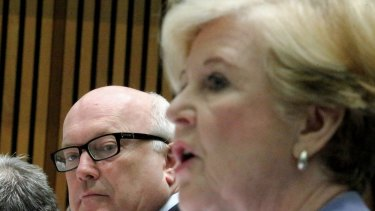 Attorney-General Senator George Brandis and Professor Gillian Triggs, President of the Human Rights Commission, during a Senate hearing at Parliament House in Canberra on Tuesday.