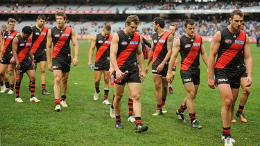 Jobe Watson leads the Essendon team off after the loss to Carlton in round 21 last year.