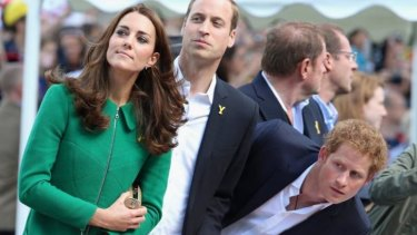 The Duke and Duchess of Cambridge, plus Prince Harry, watch as Cavendish crashes.