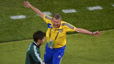Livid ... Ukraine coach Oleg Blokhin lashes out at a match official after the goal was disallowed.