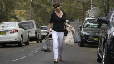 In the bag: Margie Abbott walks to her Forestville home.