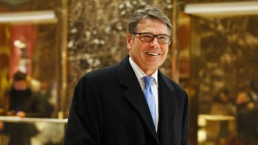 Former Texas governor Rick Perry smiles as he leaves Trump Tower.