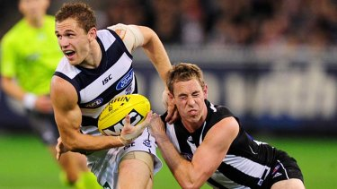 Geelong skipper Joel Selwood tries to escape the clutches of his opposite number, Nick Maxwell.