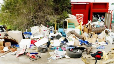 Useless donations: charity bins have become dumping sites as landfill costs rise.
