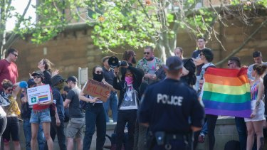 Protesters standing against the Party For Freedom's Straight Lives Matter rally in Green Park, Sydney.