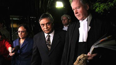 Jayant Patel, flanked by his wife Kishoree and his lawyers, returns to court to hear his fate.