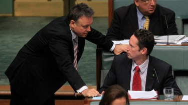MP for Throsby Stephen Jones is spoken to by the Chief Government Whip Joel Fitzgibbon during question time yesterday.