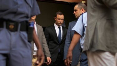 Oscar Pistorius, centre, leaves North Gauteng High Court at the end of the fourth day of his trial on Thursday in Pretoria.