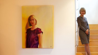 Fiona Sharkie, pictured next to a portrait painted by local artist Beverley Craig, has taken up the cudgel for those with ASD.