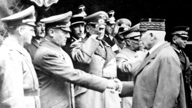 Otto Abetz shakes hands with Vichy leader Marshal Philippe Petain in 1941.