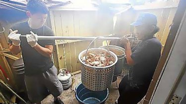 Cuong Nguyen (left) and his father, Son Le, at work in their seafood restaurant.