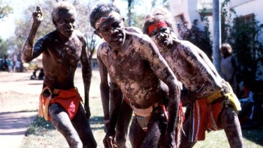 Edward Nemarluk, Tommy Moyle and John Chula dancing at Wadeye, 1988.