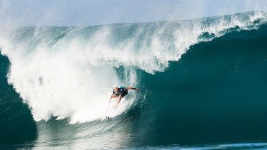 World champion: Mick Fanning in action at Billabong Pipe Masters.
