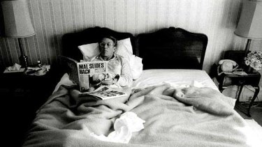 Malcolm Fraser reads the paper in his Hotel Windsor suite after his 1980 re-election win.