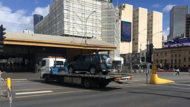 The RAV4 vehicle being towed away from the scene.
