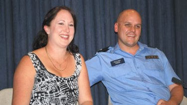 Bashed police officer Matt Butcher pictured with his wife Katrina will receive a record payout from the State Government to cover injuries sustained while he was on the job.