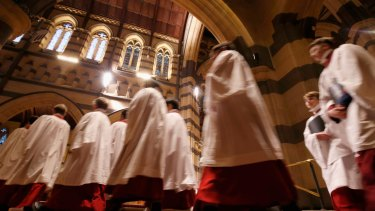 Choir boys walk into St Paul's Cathedral  during the Choral Eucharist.