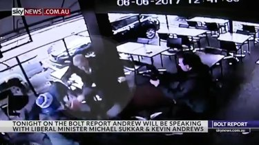 CCTV footage shows Andrew Bolt being set upon by protesters outside a book launch in Melbourne on Tuesday.