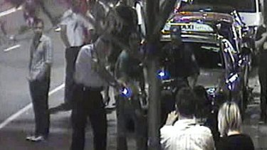 Alleged misuse ... Police stand guard over a man that was tasered twice in the back. The man is pursuing civil action.