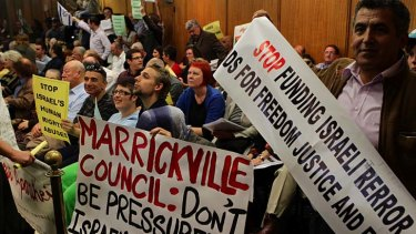 Push and pull ... residents for and against the boycott against Israel gathered in the Marrickville Council chambers for the meeting on Tuesday.
