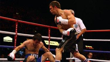 Toowoomba's Michael Katsidis knocks down England's Graham Earl at Wembley in 2007.