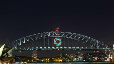 Isn't she pretty ... the light show test on the Harbour Bridge. Thousands of aerial shells and comets will be released from the bridge, barges and rooftops before an expected worldwide audience of 1 billion.