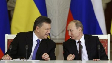 Signed: Ukrainian President Viktor Yanukovych gives a wink to his Russian counterpart Vladimir Putin.