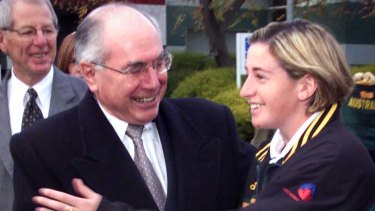 As a teenager with former prime minister John Howard.