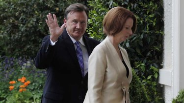 Prime Minister Julia Gillard and partner Tim Mathieson arrive for the ceremony at Government House.