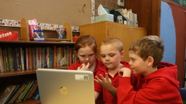 School children work off a computer at Darlington Public School.