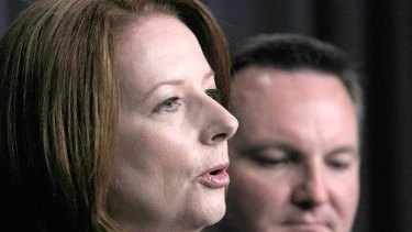 """Prime Minister Julia Gillard and Immigration Minister Chris Bowen: Deal with Malaysia a """"big blow"""" to people smugglers."""