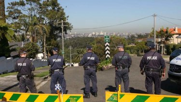 Road block ... police search along Burrawong Avenue in Mosman yesterday morning after Wednesday's bomb scare.