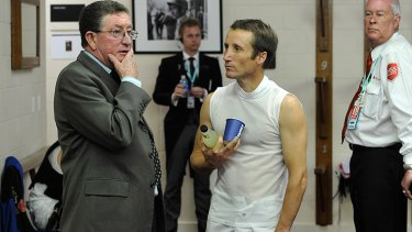 Under pressure ... Jockey Damien Oliver at Flemington this morning.