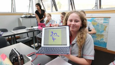 Student Genevieve Law uses electronic textbooks.