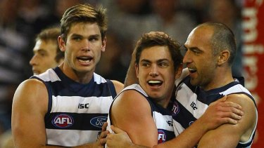 How about that: Geelong's Dan Menzel (centre) celebrates a goal on Friday night with Tom Hawkins (left) and James Podsiadly.