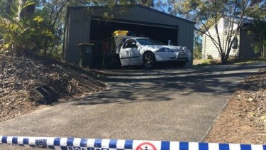 Police remove chemicals from the garage of the Pullenvale home.
