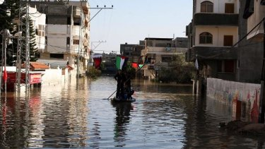 Civil defence teams in Gaza try to rescue people caught in flooding in December 2013.