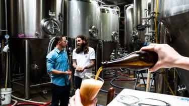 Jake Steele, solar energy specialist, left, and Oscar McMahon, co-owner and brewer from Young Henrys.