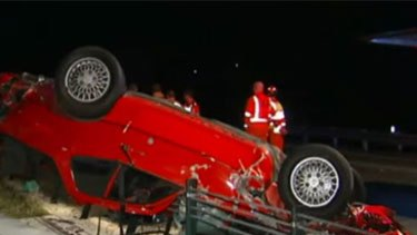 The 'dead' man was being pulled from the wreckage of this Porsche when an SES volunteer discovered he was still alive.