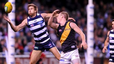 Geelong's Tom Lonergan and Richmond's Jack Riewoldt vie for possession.